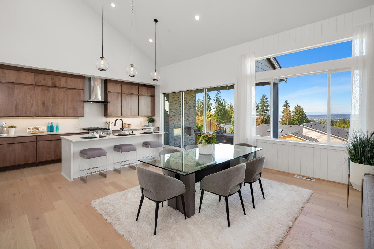 Kitchen and dining with access to covered patio through sliding glass doors