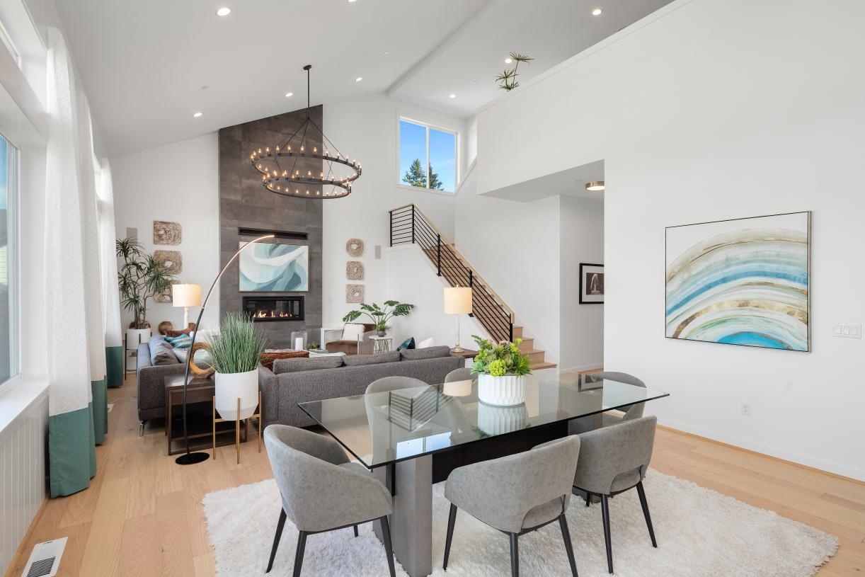 Great room features a dramatic vaulted ceiling