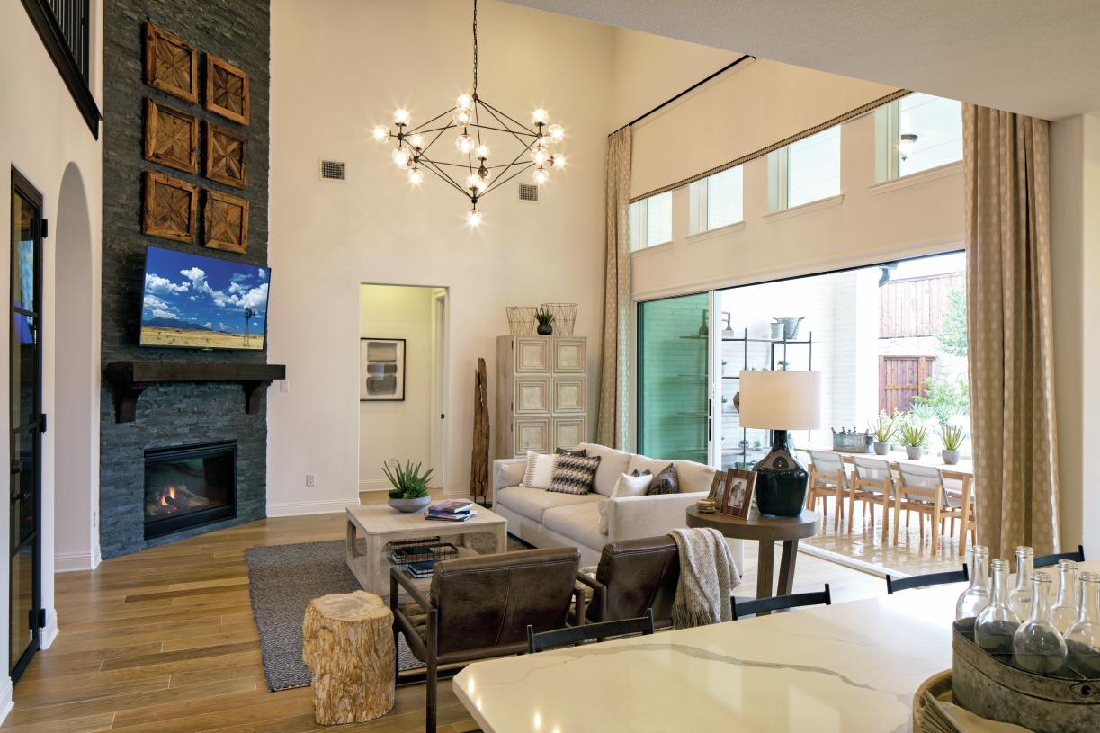 Impressive two-story great room boasts a radiant fireplace