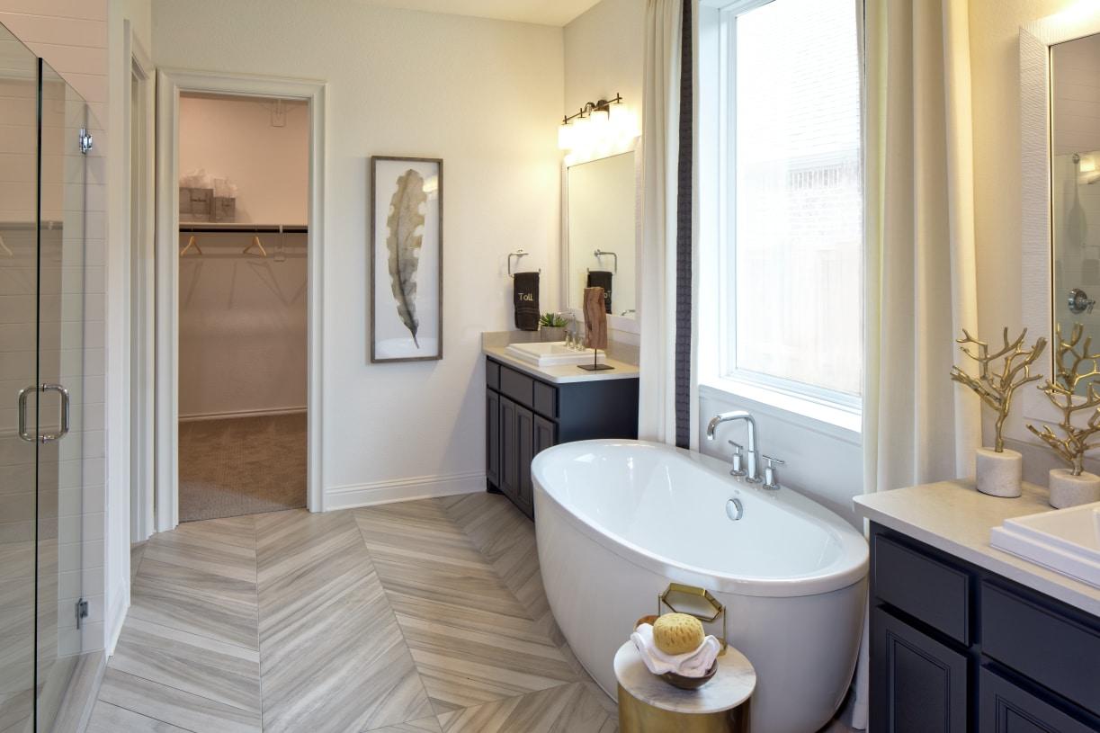 Resort-style primary bath with dual vanities