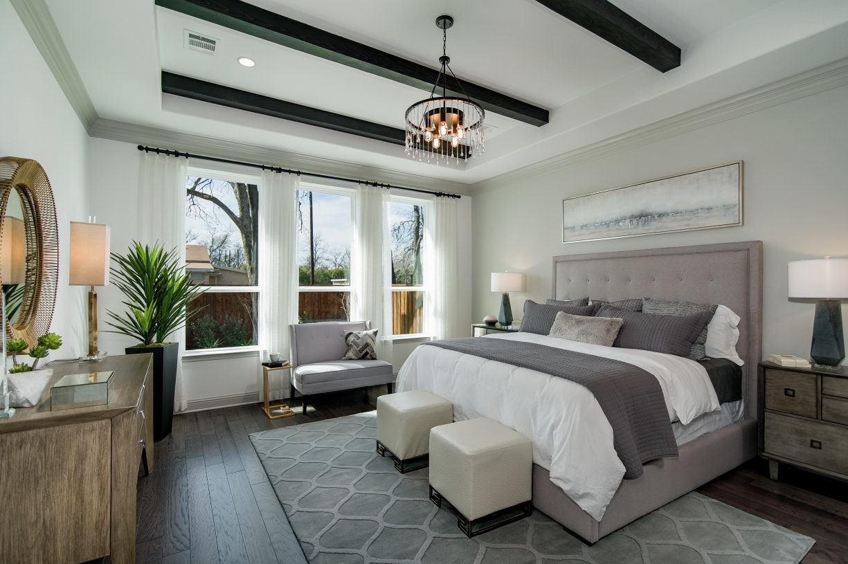 Primary bedroom suite is enhanced by a trayed ceiling