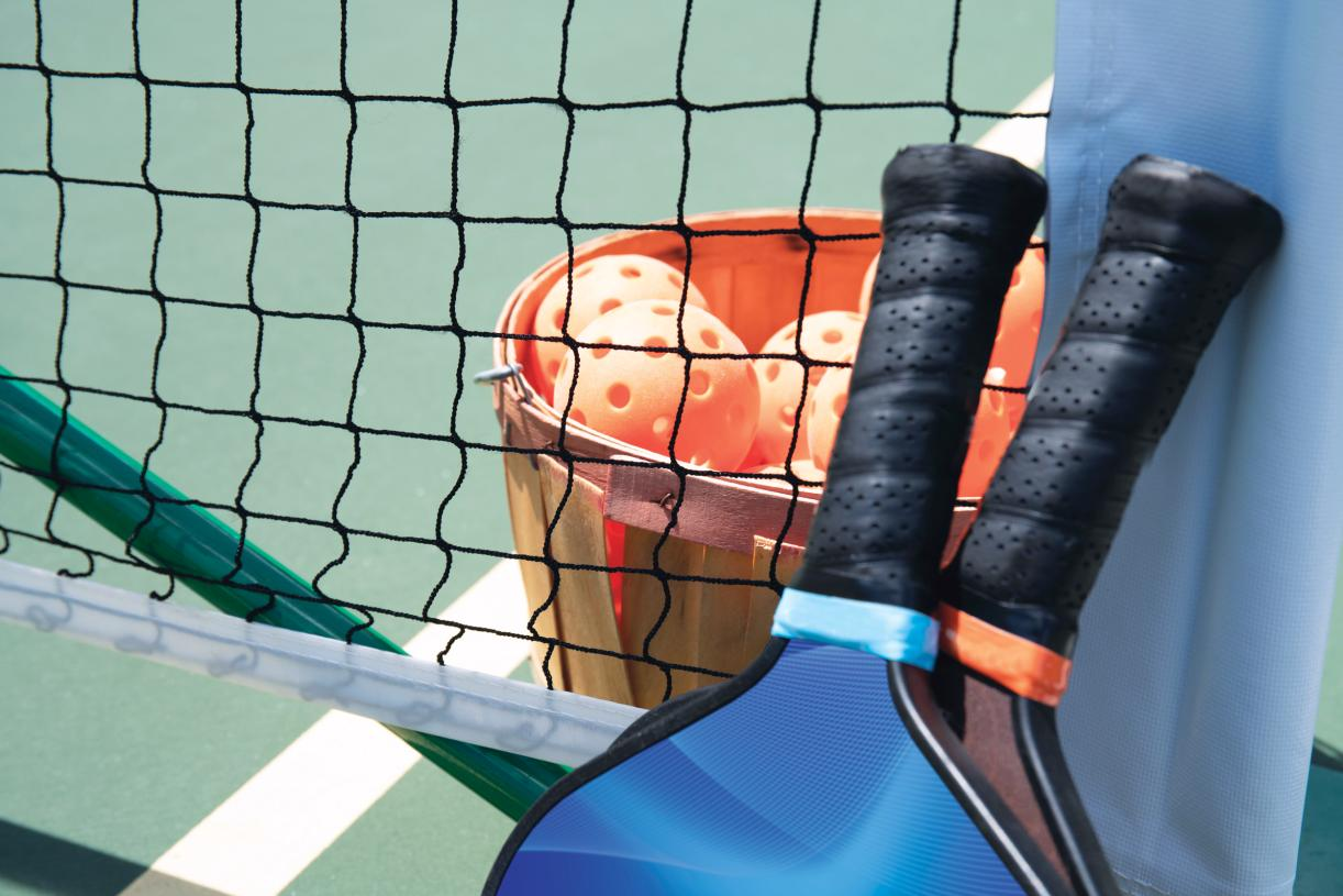 Play a game of pickleball with your neighbors on the weekend