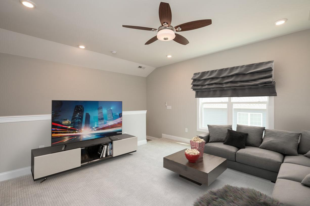 The loft space can easily transition into a Media Room for entertaining guests