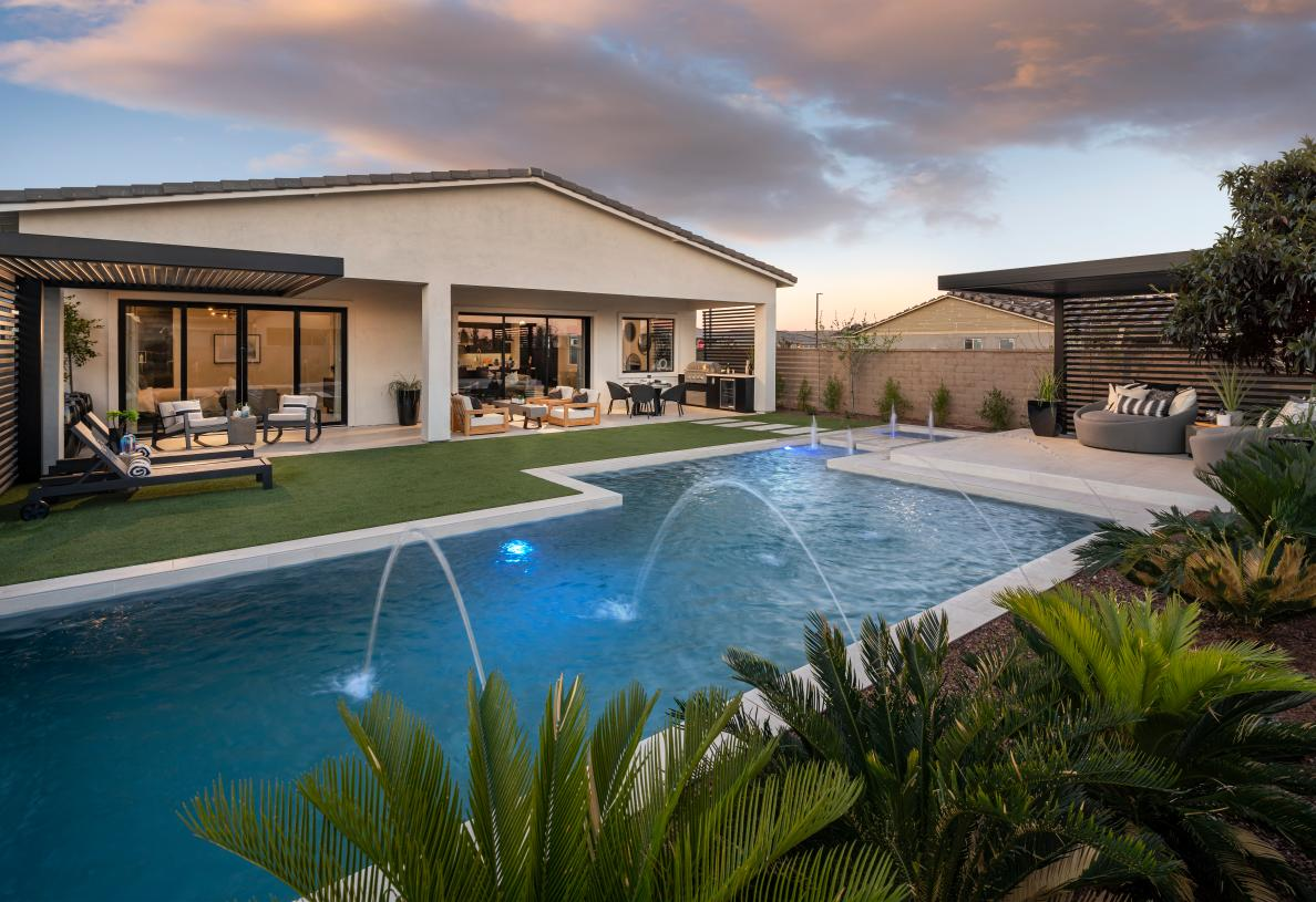 Resort-style backyard with pool and outdoor kitchen