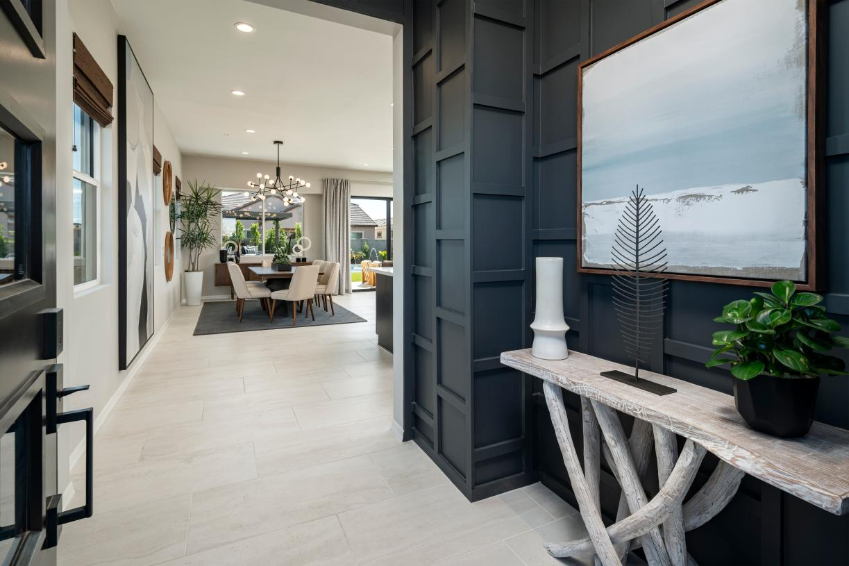 Welcoming foyer entry with views to the dining room, great room, and desirable covered patio beyond