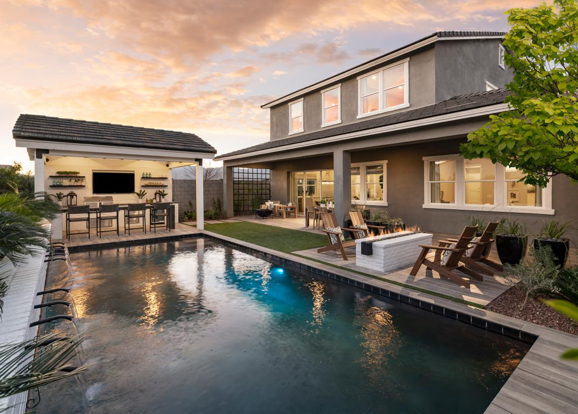 Beautiful resort-style backyard with pool and outdoor kitchen