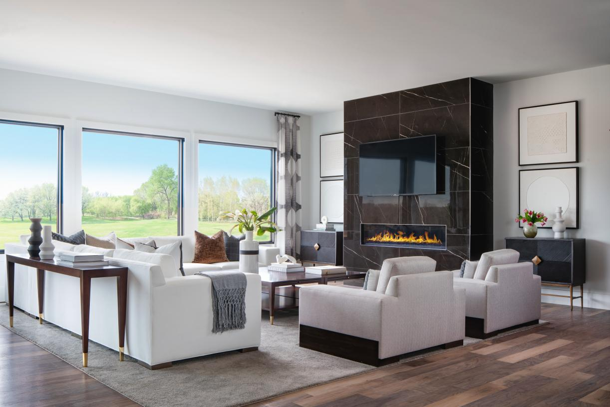 Expansive great rooms with designer fireplaces