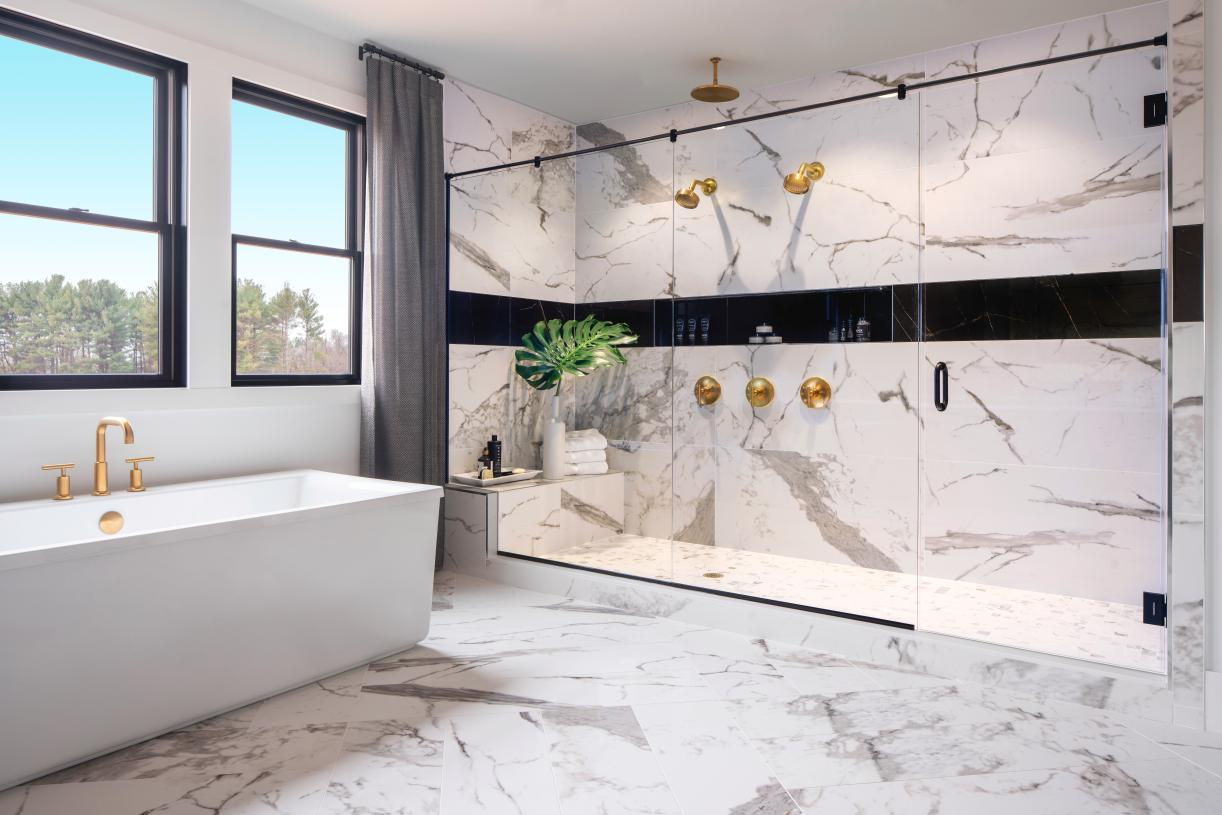 Lavish primary baths with dual vanity sinks, free-standing tubs, and luxe walk-in showers