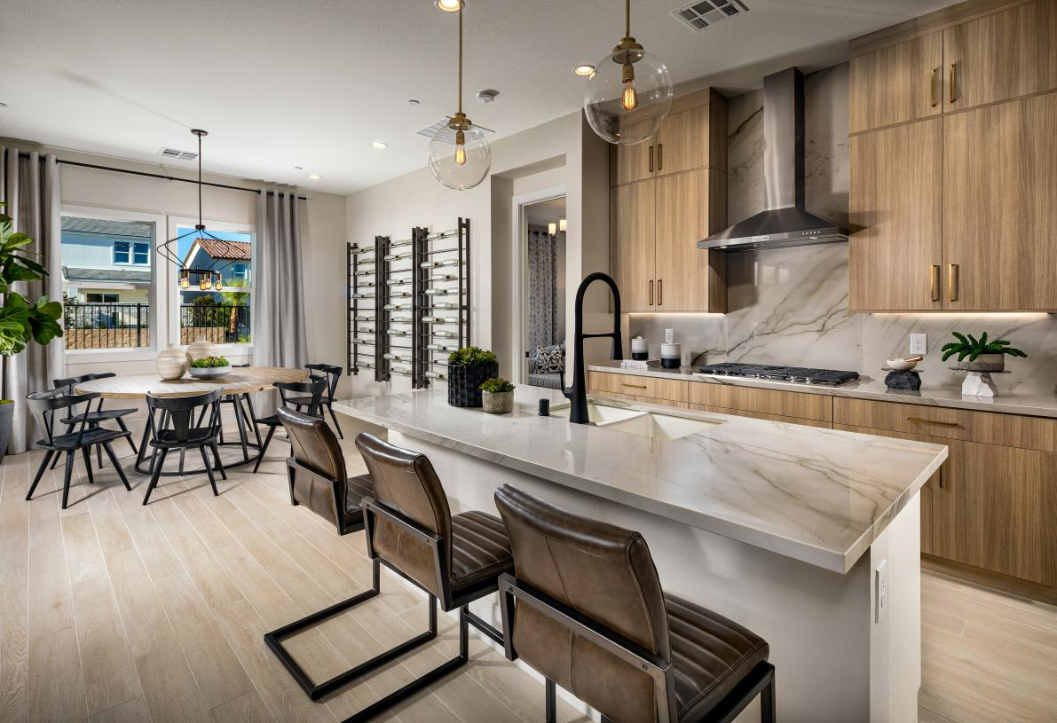 Well-designed kitchen with breakfast bar and adjacent casual dining area