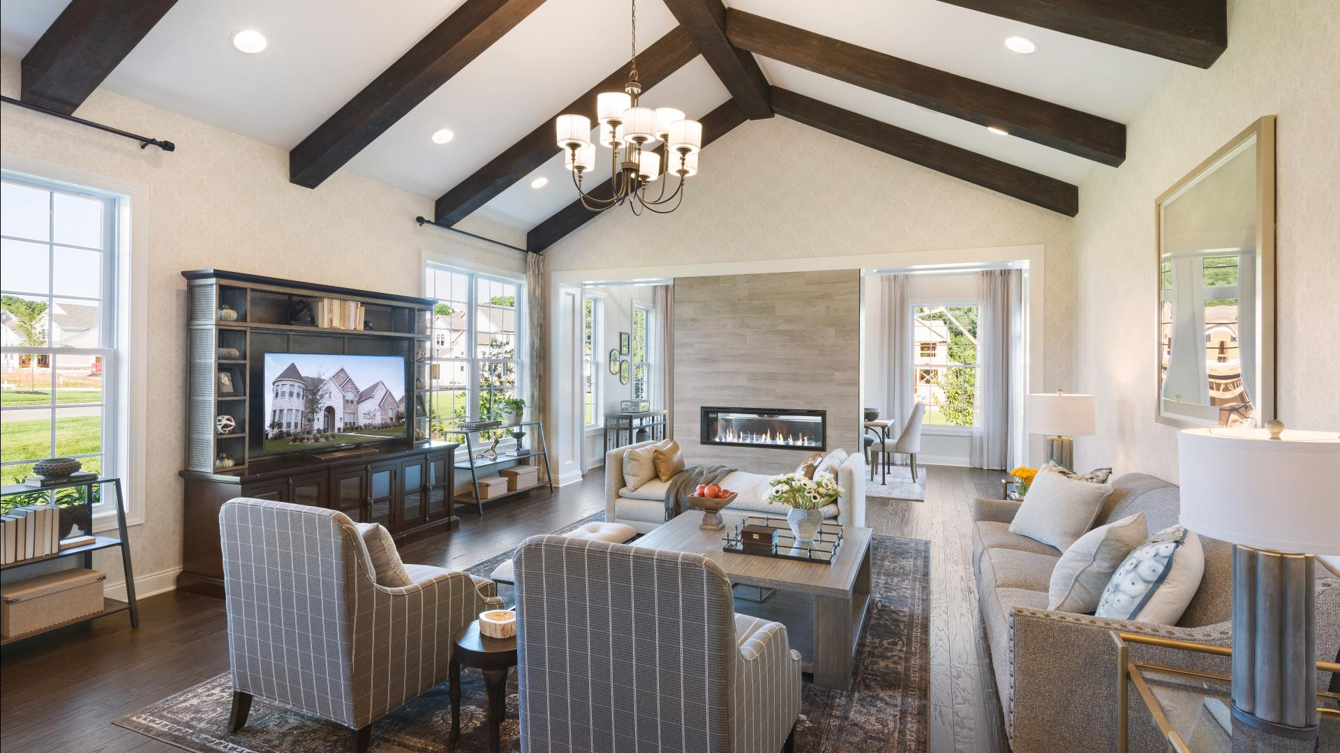The great room is the perfect setting for relaxation with its cozy fireplace and ample natural light