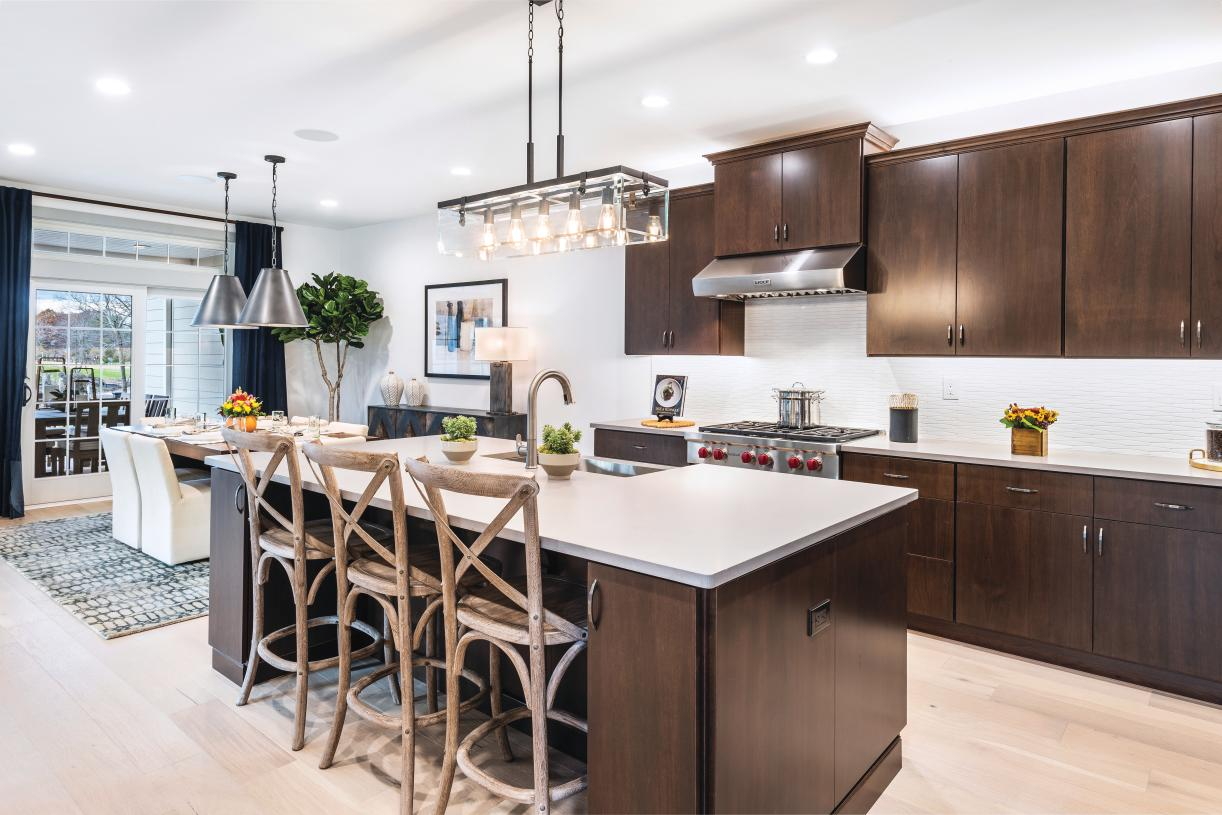 The gourmet kitchen makes a statement with its premium finishes, upgraded cabinets, and stainless steel appliances
