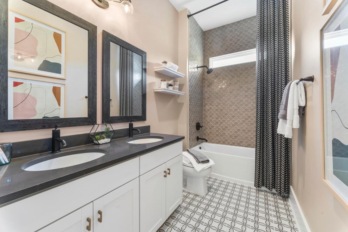 Secondary bathrooms with dual vanities