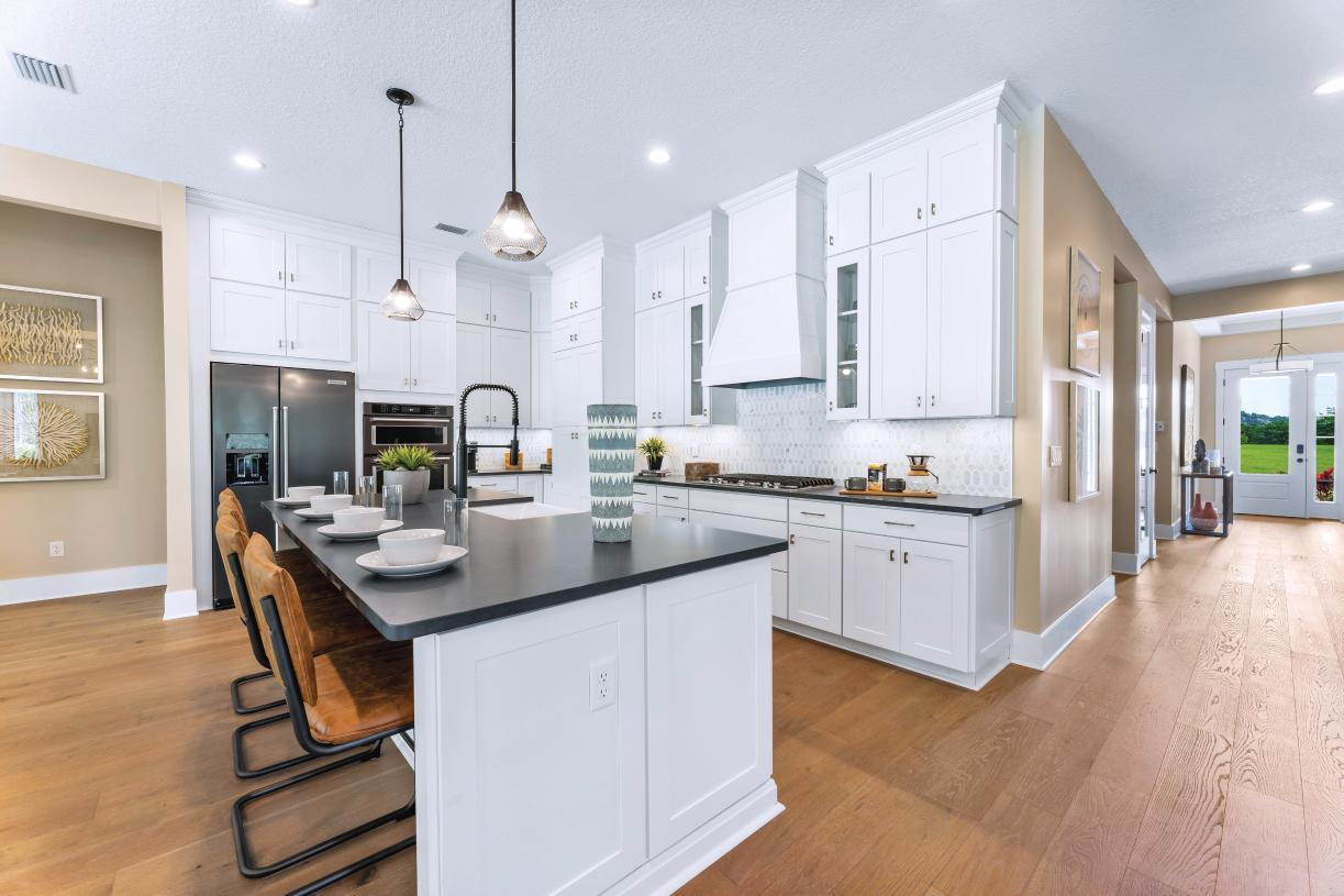 Gourmet kitchen with large island and hidden pantry