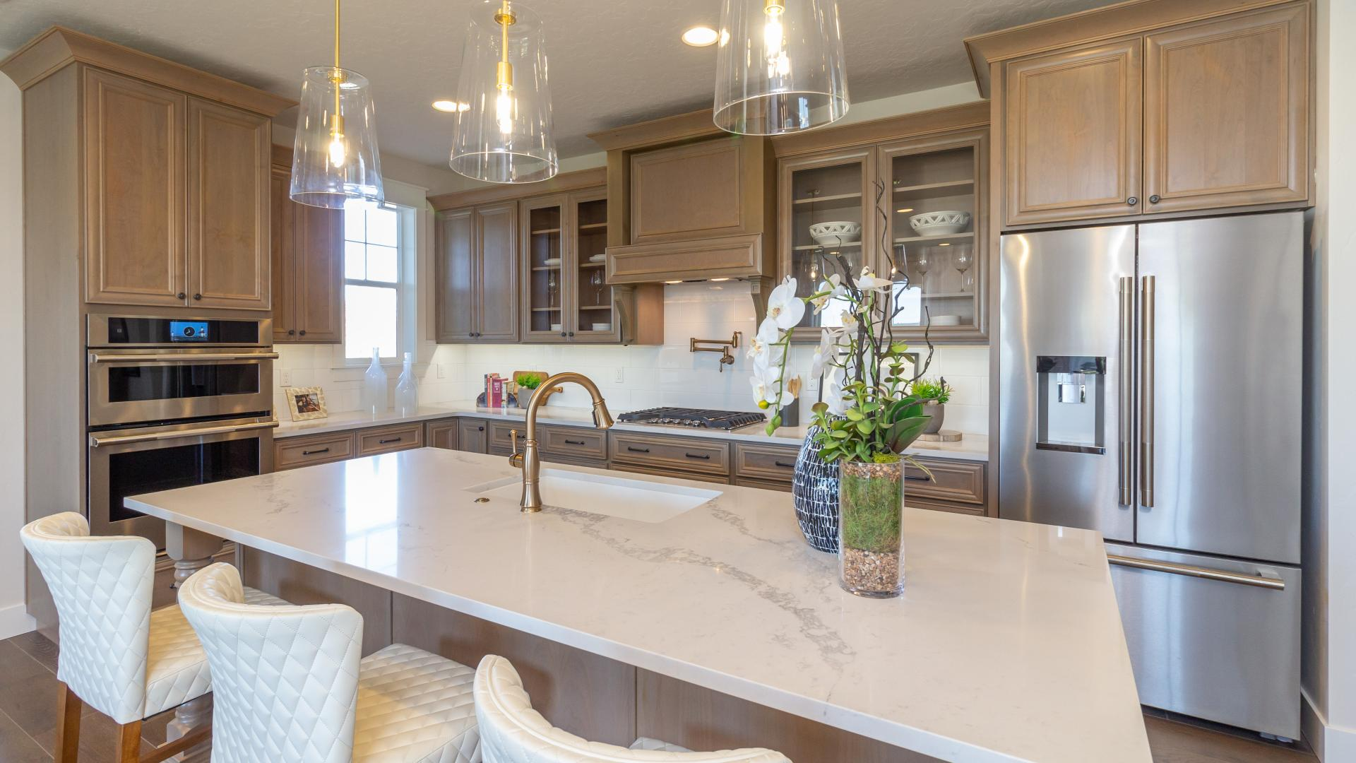 Spacious kitchen with double wall-oven and pot-filler faucet