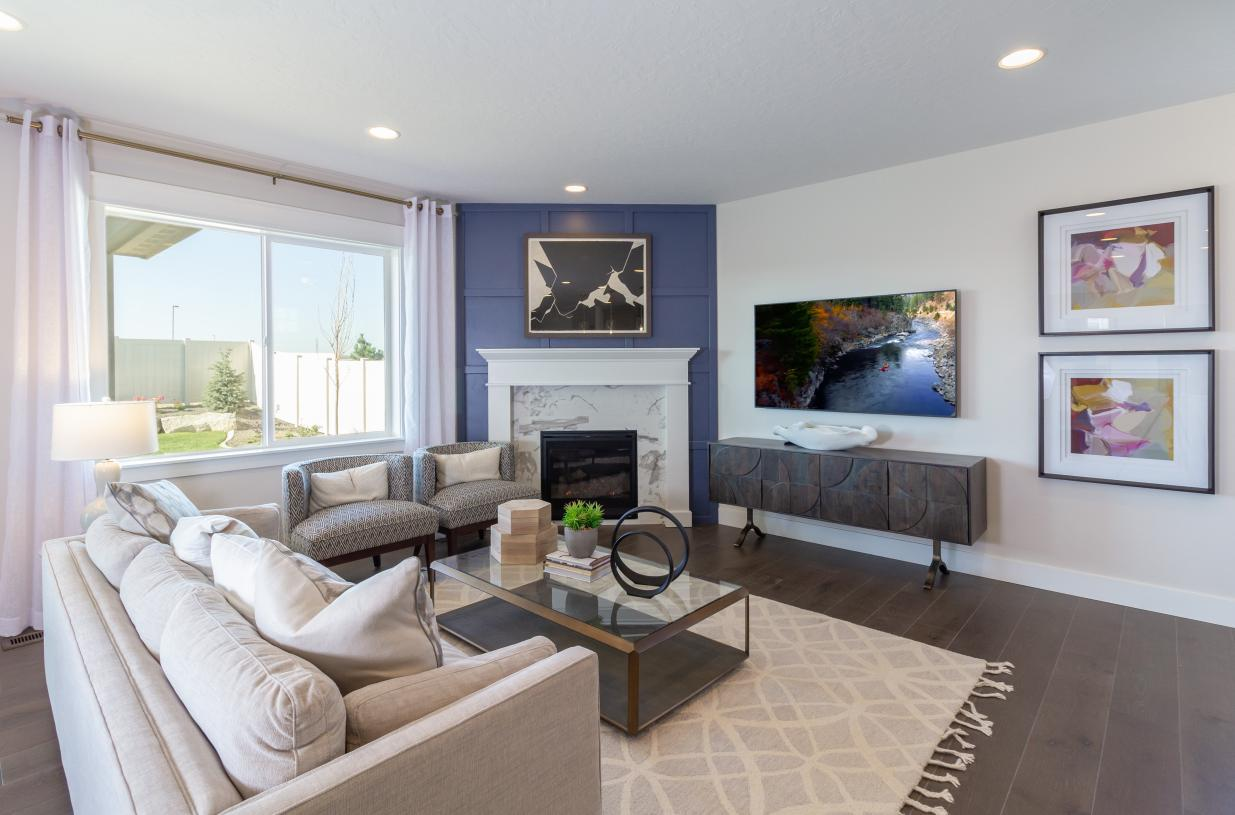 This expansive great room showcases a beautiful corner fireplace