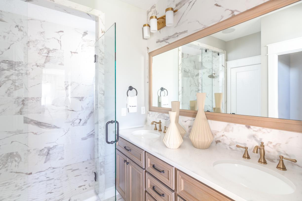 Elegant primary bath with dual-sink vanity and deluxe walk-in shower