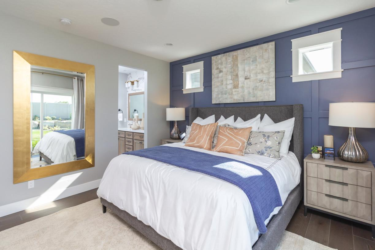 Tranquil primary suite offers abundant natural light