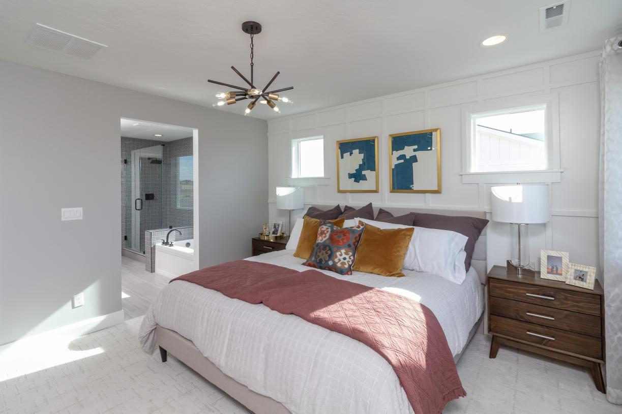Stylish primary suite offers ample room to relax