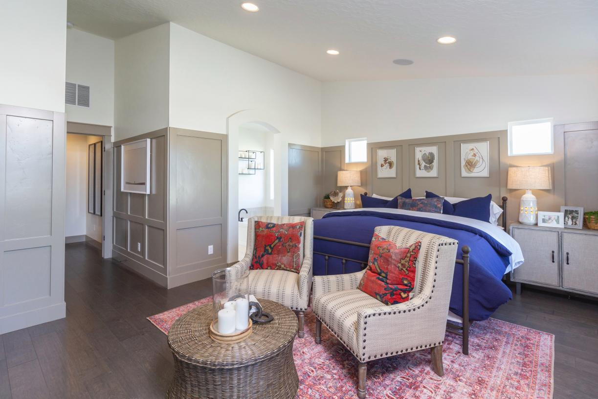 Luxurious primary suite offers privacy and comfort