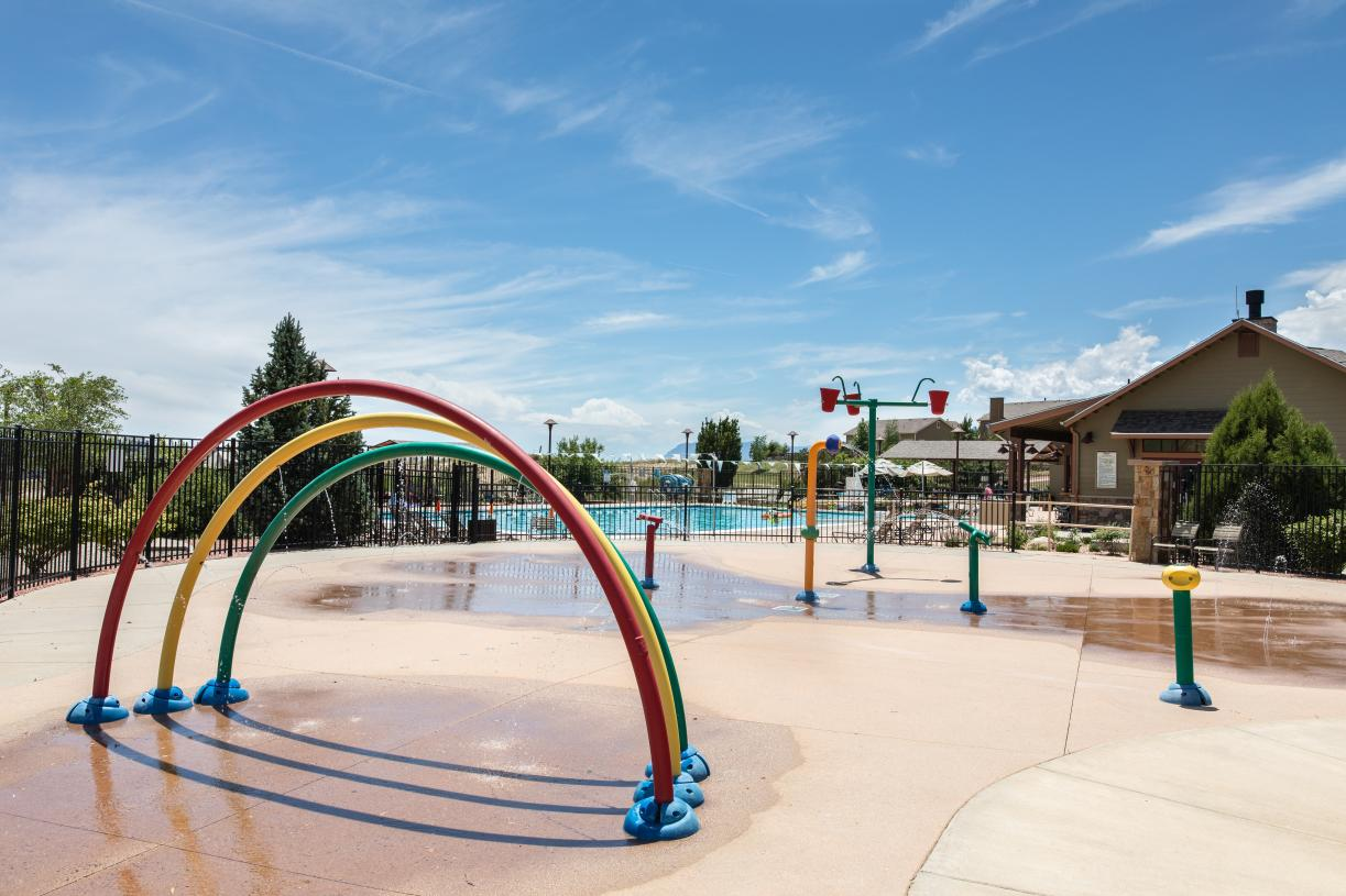 Spend summer days with family at the community pool and splash zone