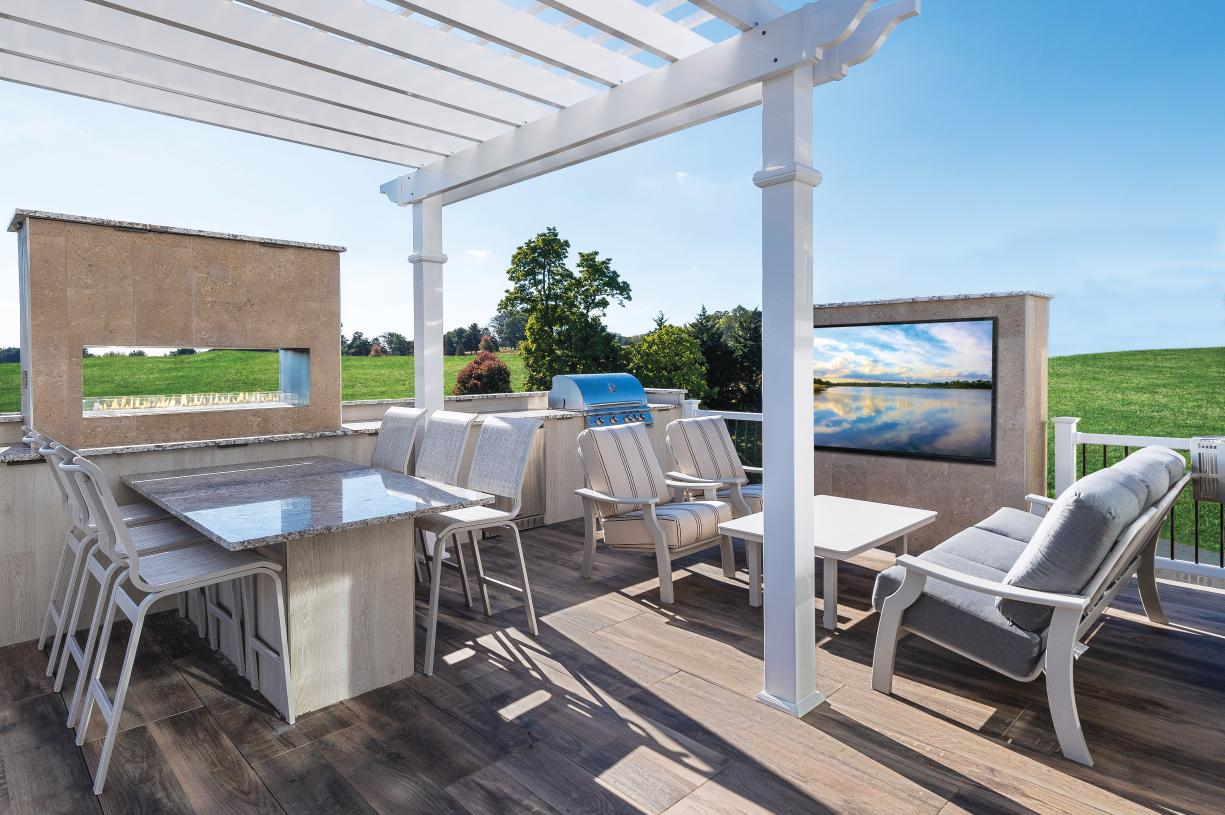 Enjoy luxury outdoor living, complete with grill and fireplace
