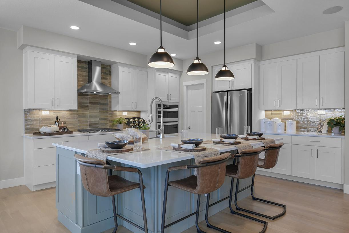 The kitchen offers a large, centered island providing additional seating