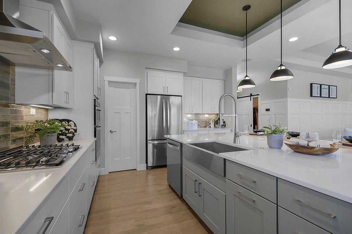 An abundance of cabinetry for storage and convenient, corner walk-in pantry