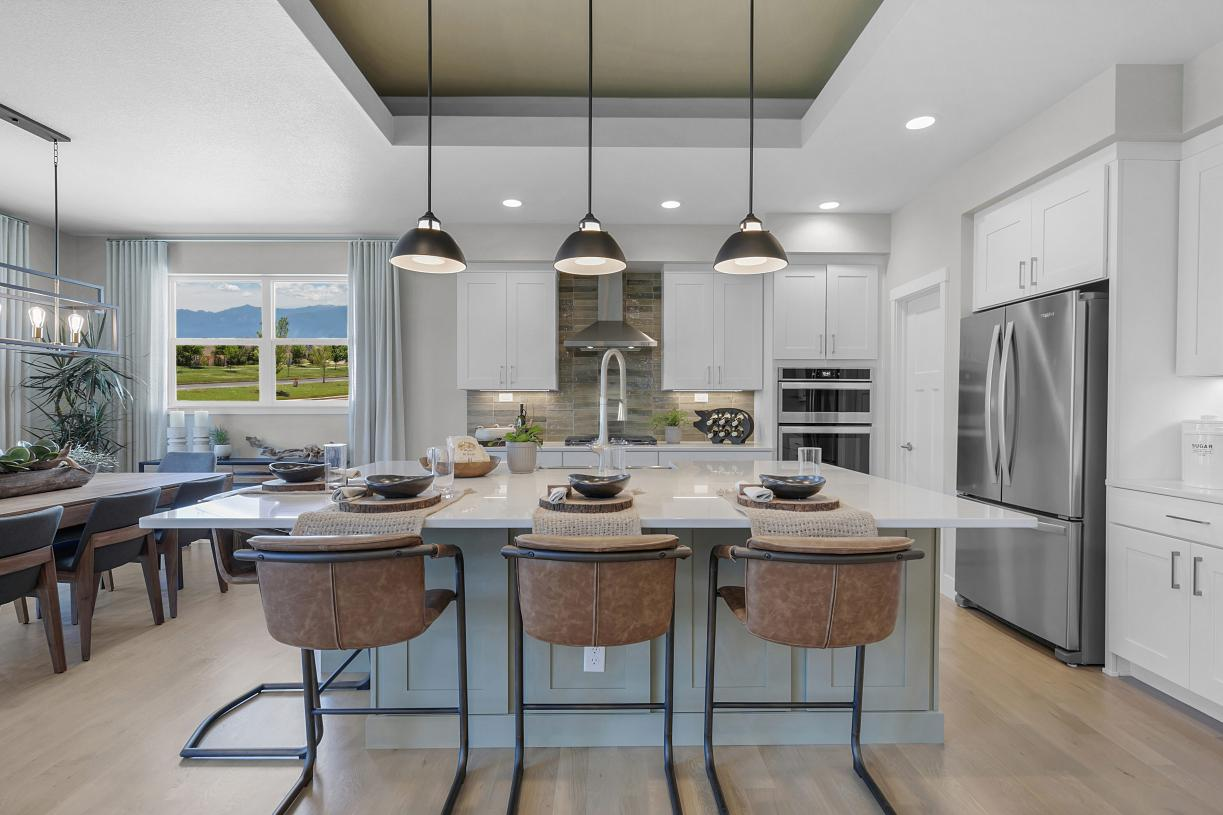 Kitchen featuring stone countertops, maple cabinetry, stainless appliances and more
