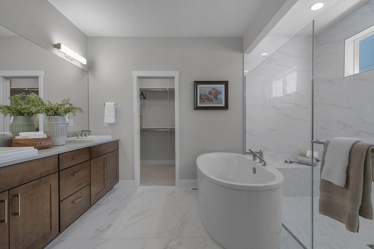 Desirable soaking tub and large walk-in shower in the primary bathroom