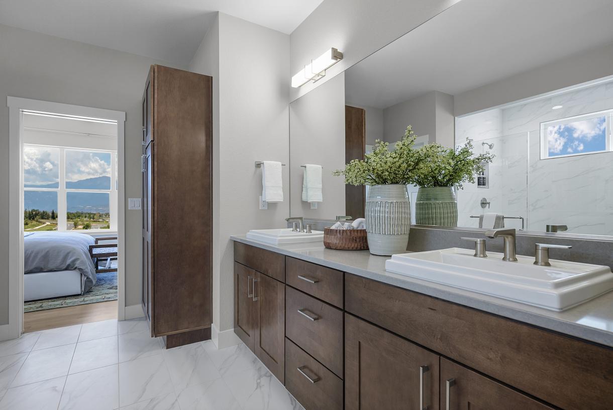Primary bathroom with dual sink raised vanity