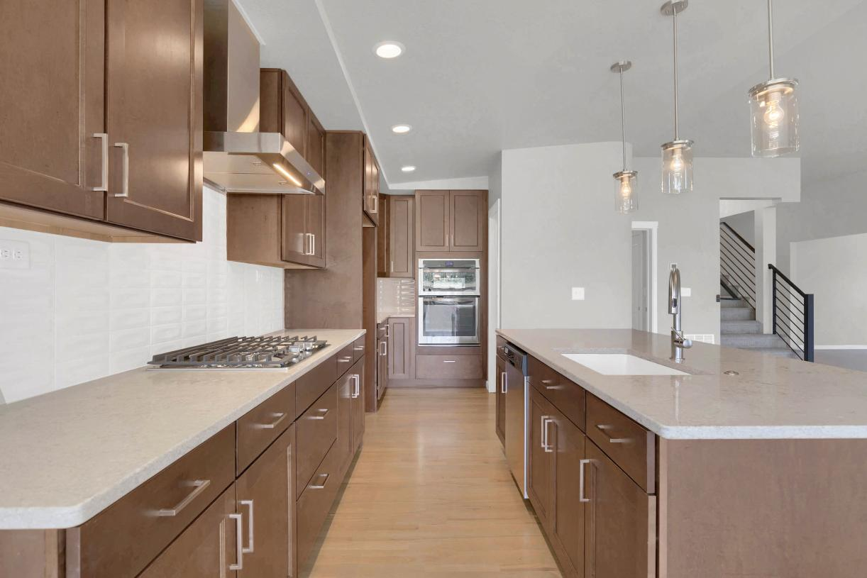 Spacious kitchen featuring a large island and plenty of countertop space for meal prep