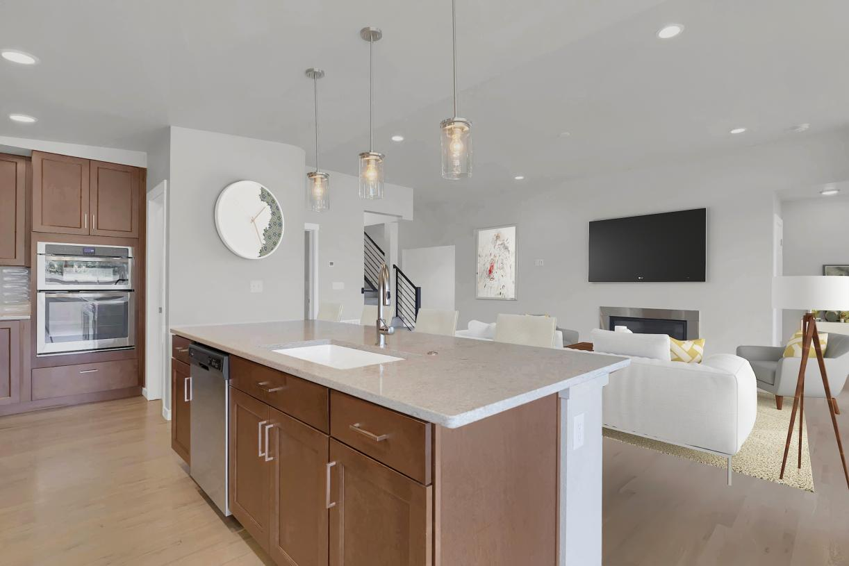 The kitchen looks out to the great room area with the gas fireplace as the focal point