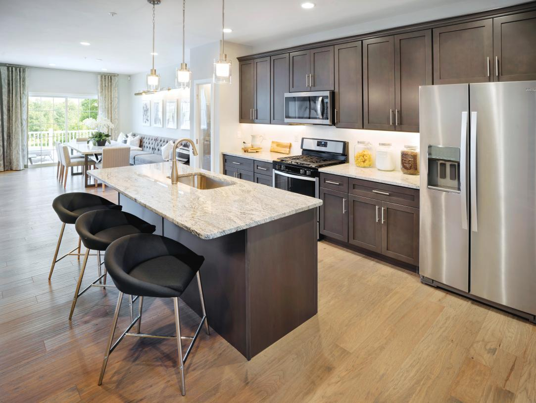 Representative Photo: Well-equipped kitchen with large center island and casual dining area