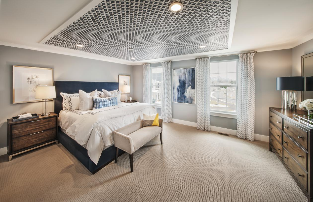 Primary bedroom suite features expansive walk-in closet and spa-like primary bath