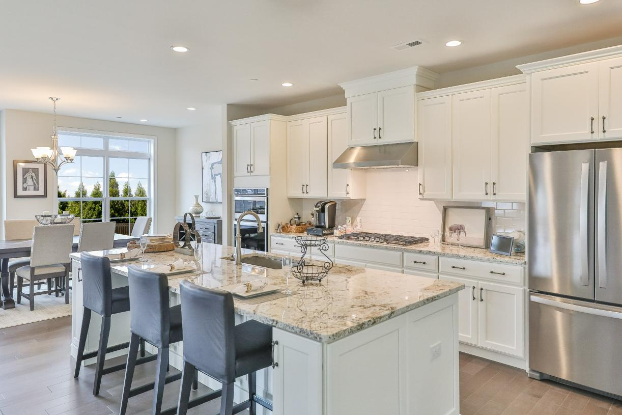Kitchen features a large center island and breakfast bar