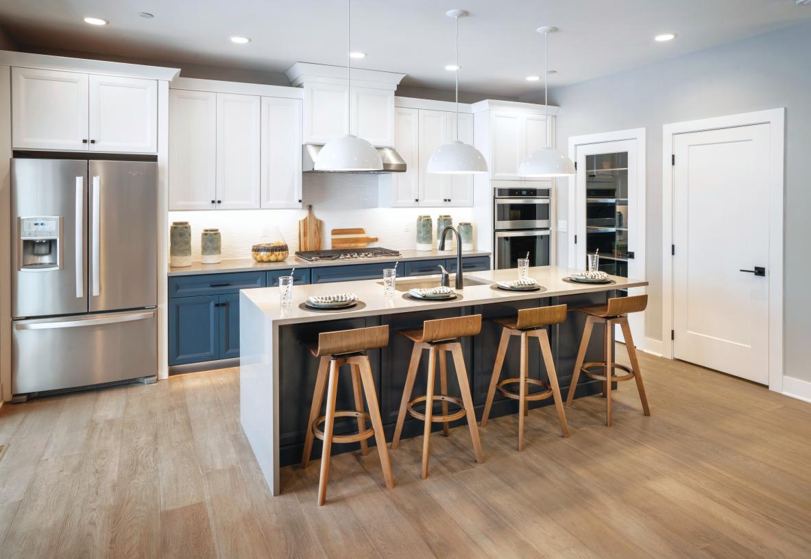 Kitchen boasts plenty of counter and cabinet space and huge walk-in pantry