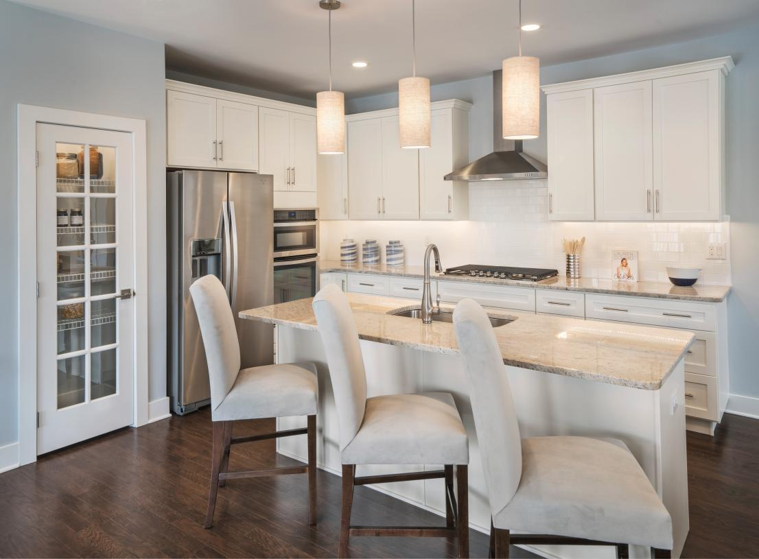 Well-designed kitchen is enhanced by a large center island