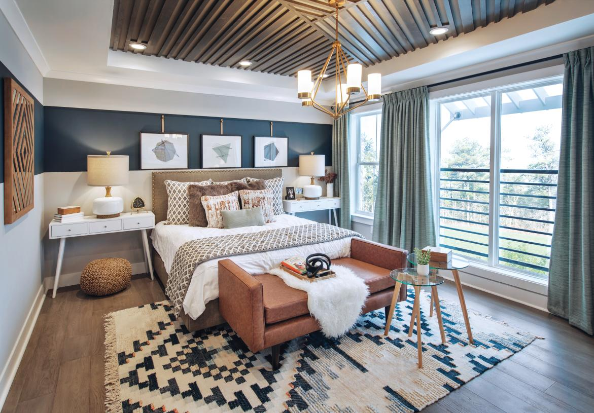 Primary bedroom suite features sizable walk-in closet and spa-like primary bath