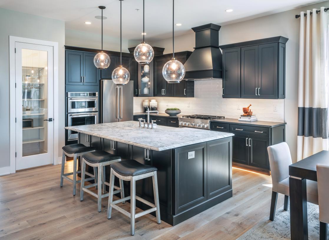 The stunning kitchen boasts a designer backsplash, modern cabinets, and upgraded countertops