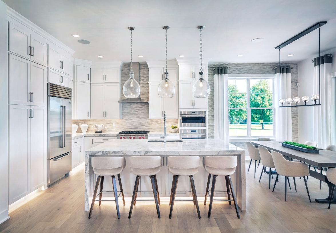 A large center island in the kitchen overlooks the casual dining area