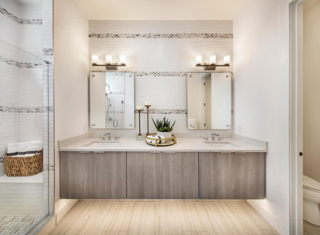 The primary bath features dual-sink vanity and large shower
