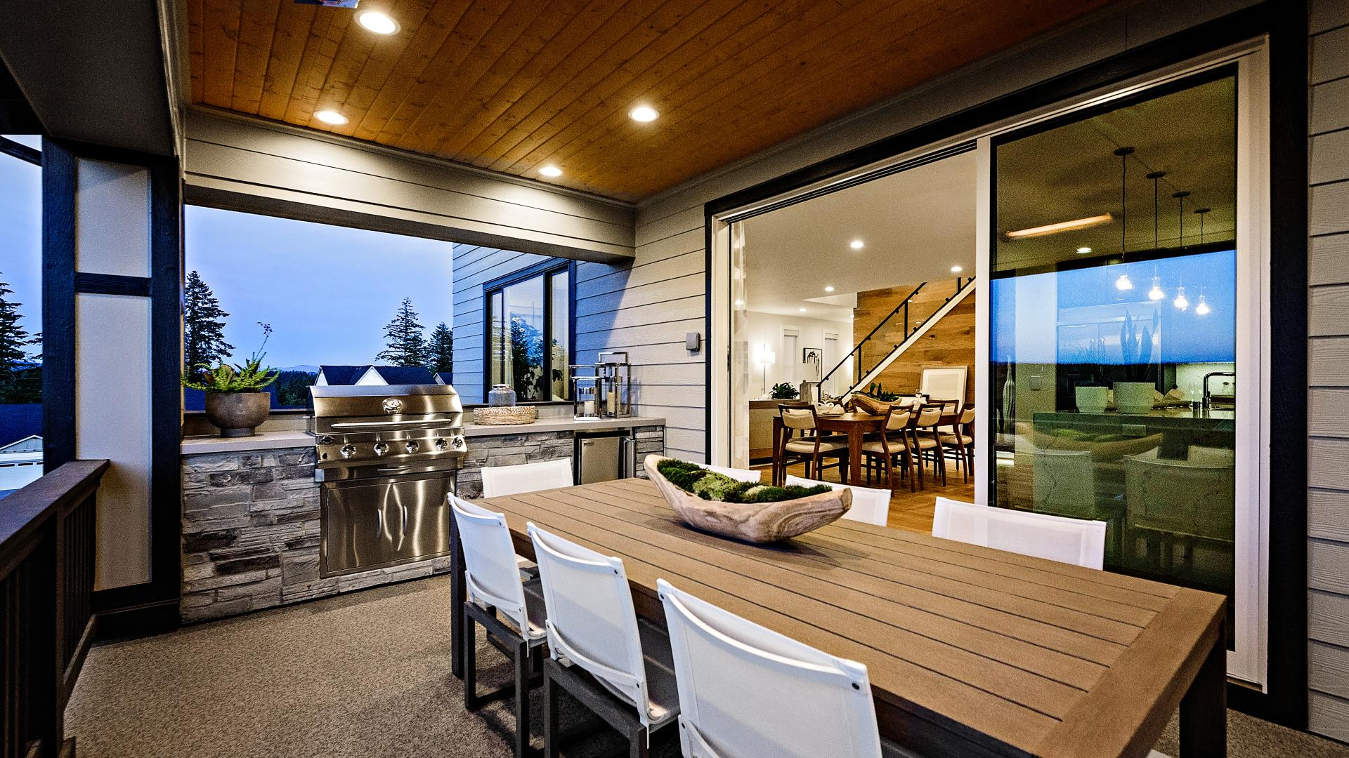 Luxury outdoor living with heaters and a cozy gas fireplace