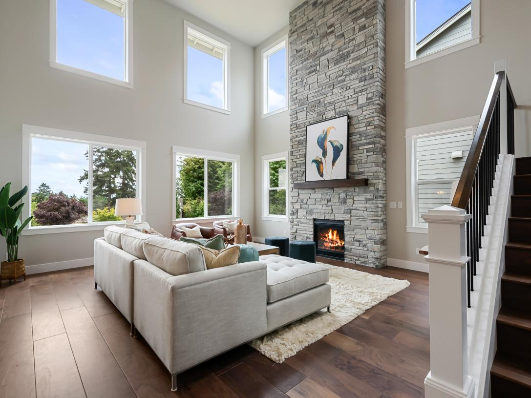 Great room with a lofty ceiling and floor-to-ceiling fireplace