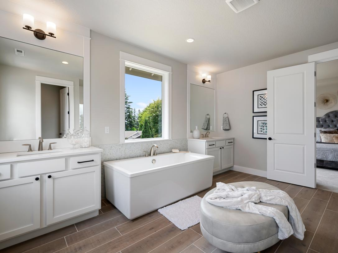 Luxe 5-piece primary bath with separate vanities and private water closet