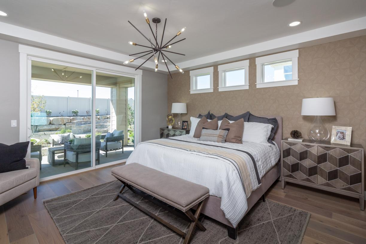 Inviting primary bedroom suites with separate covered patios