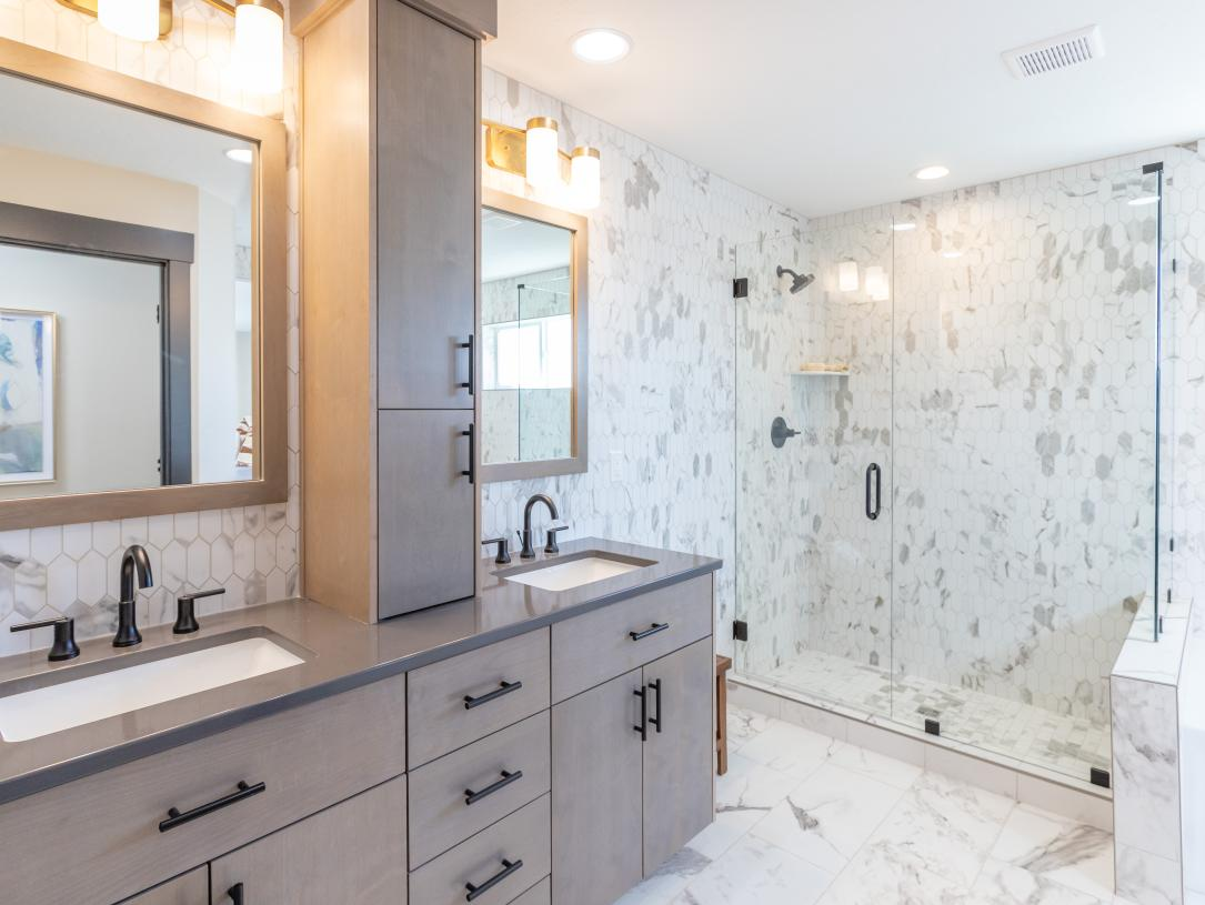 Luxurious primary bathrooms with ample storage space