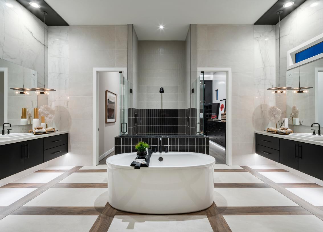 Spa-like primary bathrooms with dual vanities, large soaking tubs,  and luxe walk-in showers