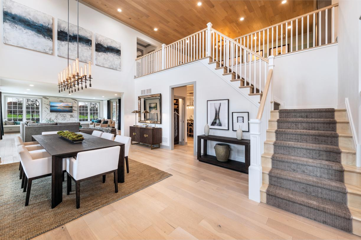 Photos are images only and should not be relied upon to confirm applicable features - Entrance foyer with open floor plan to dining area and great room