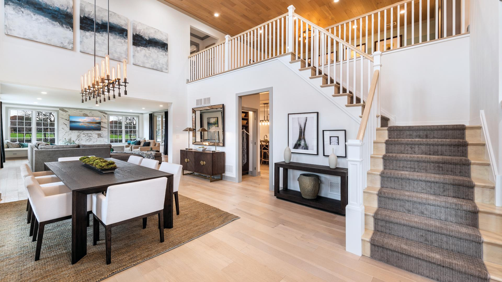 Entrance foyer with open floor plan to dining area and great room