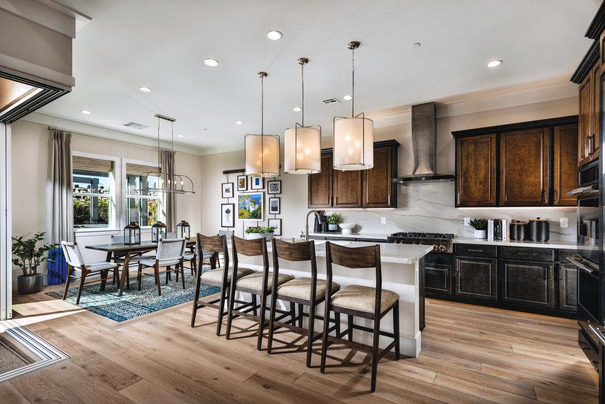 The kitchen offers expansive cabinets and counter space
